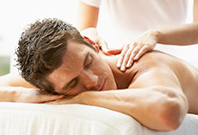 Young Man Enjoying Massage At Spa